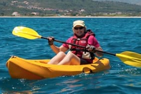 A lady kayaking in Samos, Greece