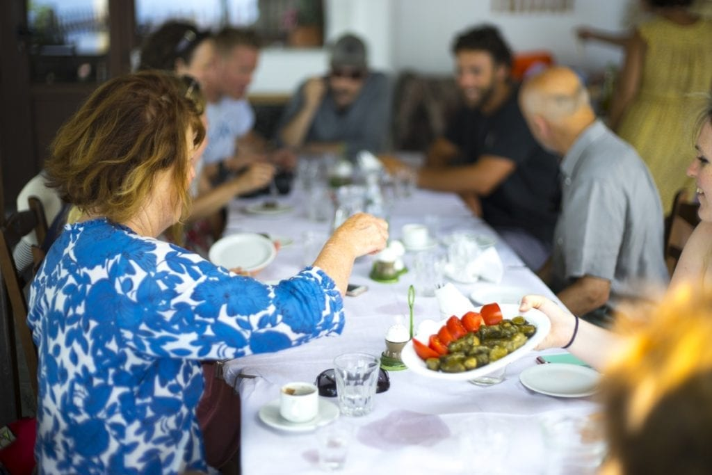 Guests having lunch together on their summer holiday in Samos, Greece