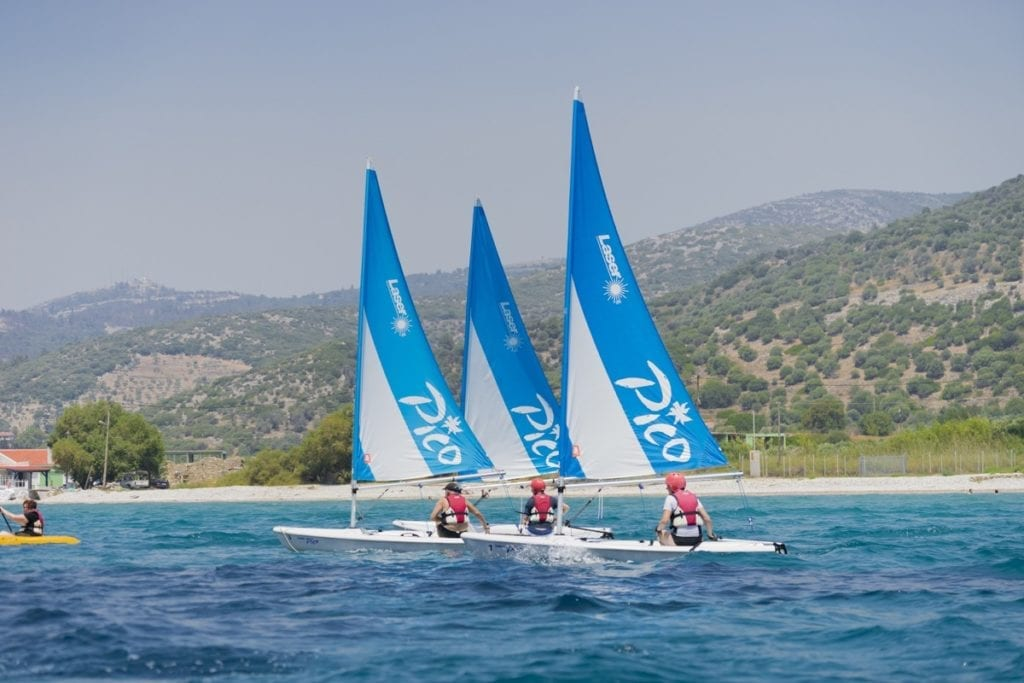 Three sailing boats on the water in Samos, Greece