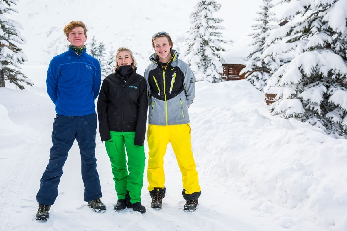 Friends wearing ski clothes ready for a day in the snow