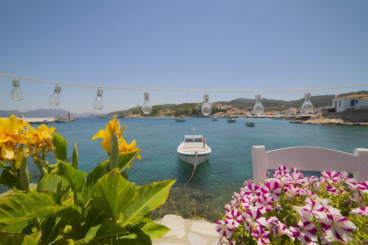 A boat and some flowers in Kokkari, Samos, Greece in summer