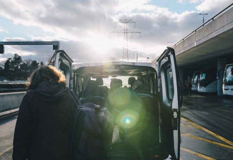 Richmond staff helping guests with their bags at the airport before the journey to the Three Valleys ski resort begins